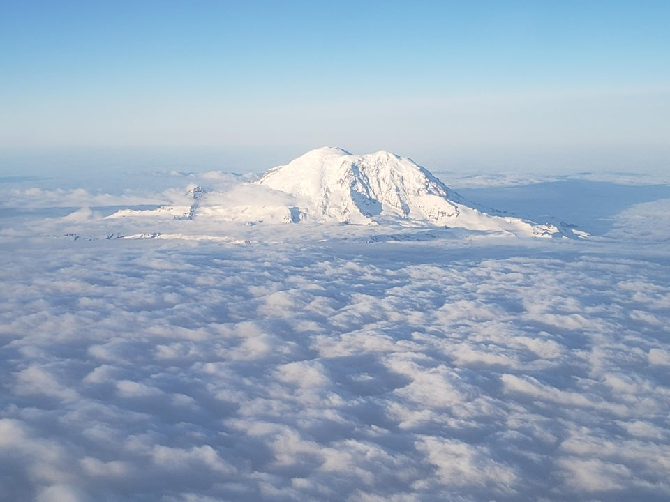 Mt.Rainier standing high above blanket of clouds