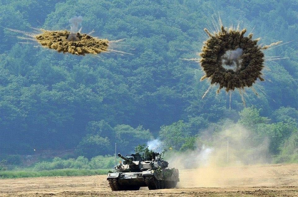 Tank amidst exploding rounds