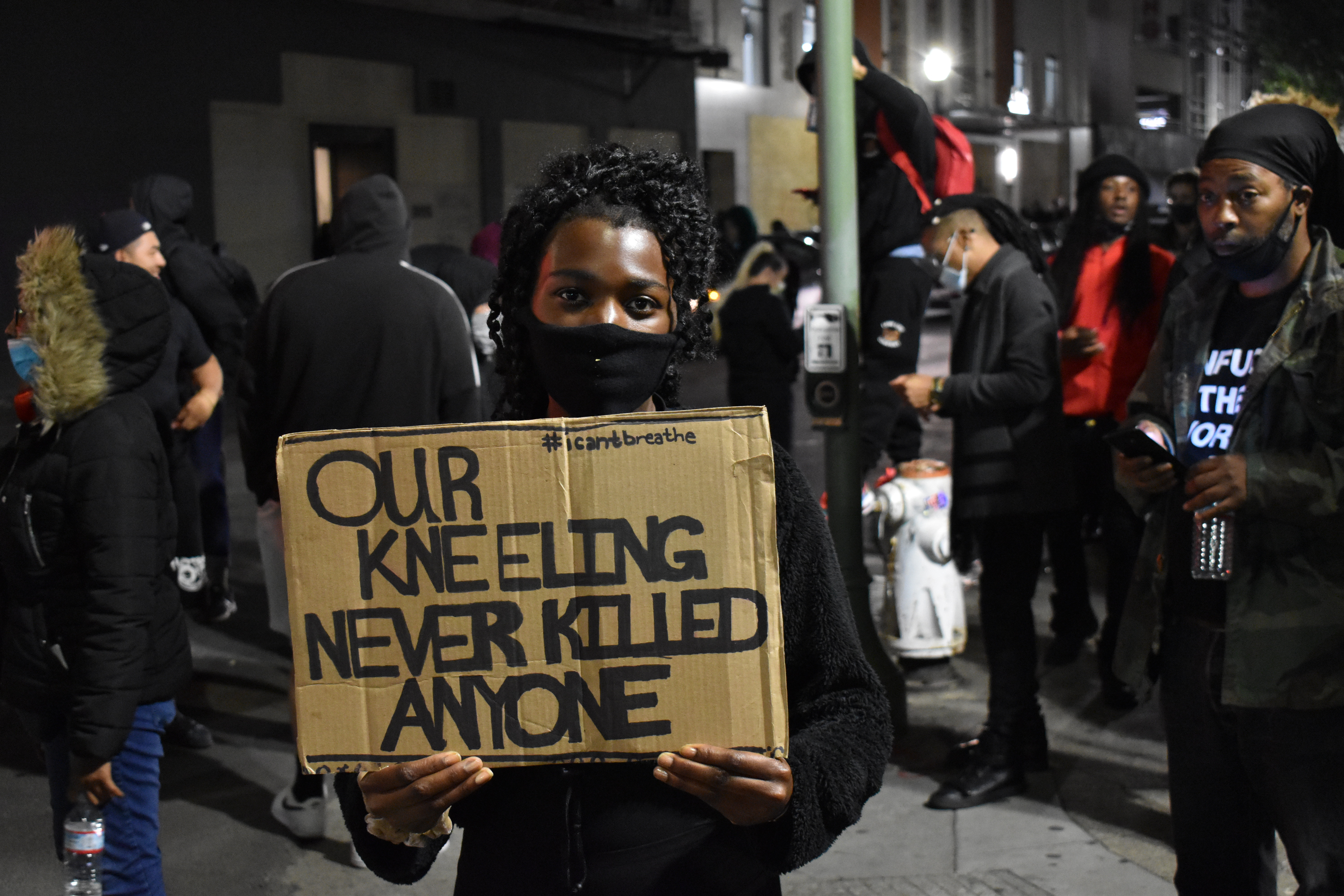 A protestor in Oakland, California holding a sign