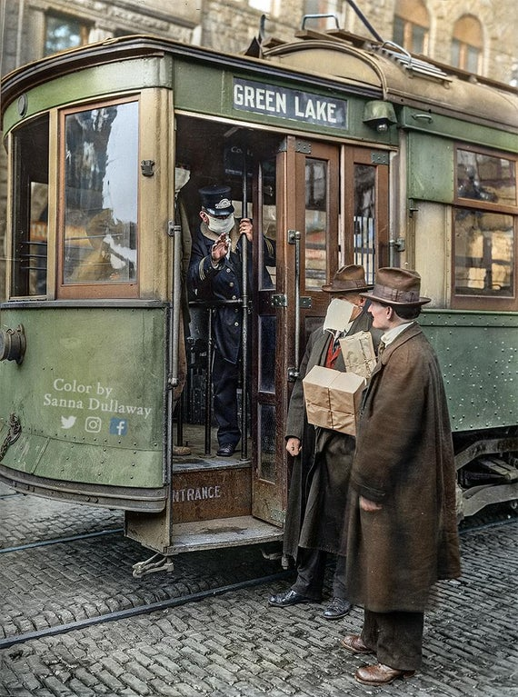 Street car conductor in Seattle not allowing passengers aboard without a mask, during Spanish Flu Pandemic in 1918