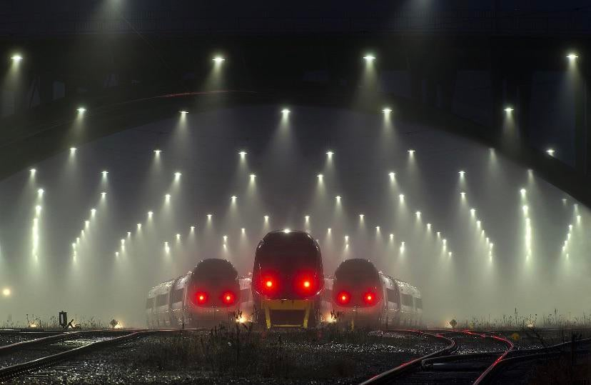 These trains in a station at night