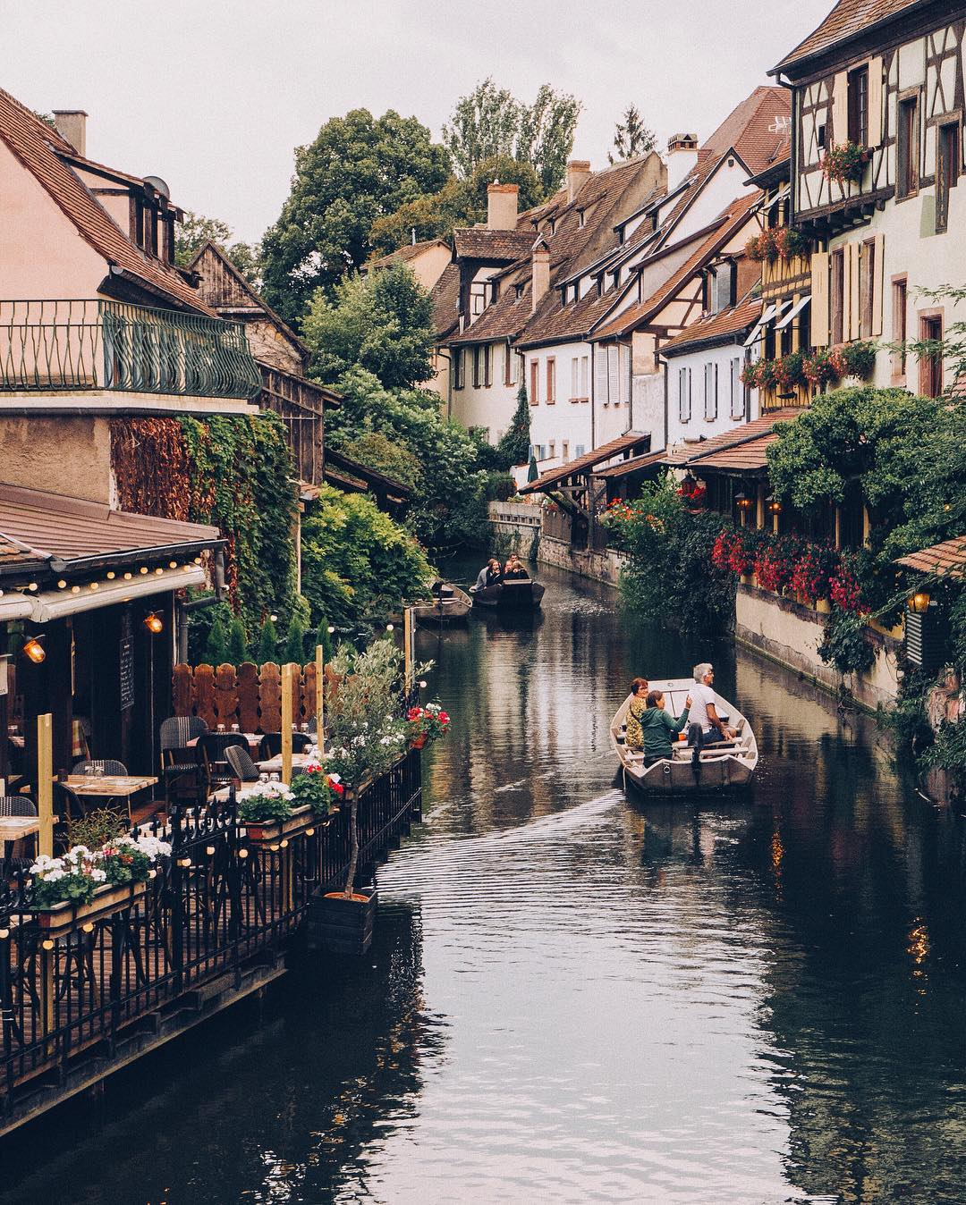 Canal of the Lauch River flowing through the historic old town in Colmar, Alsace, Eastern France
