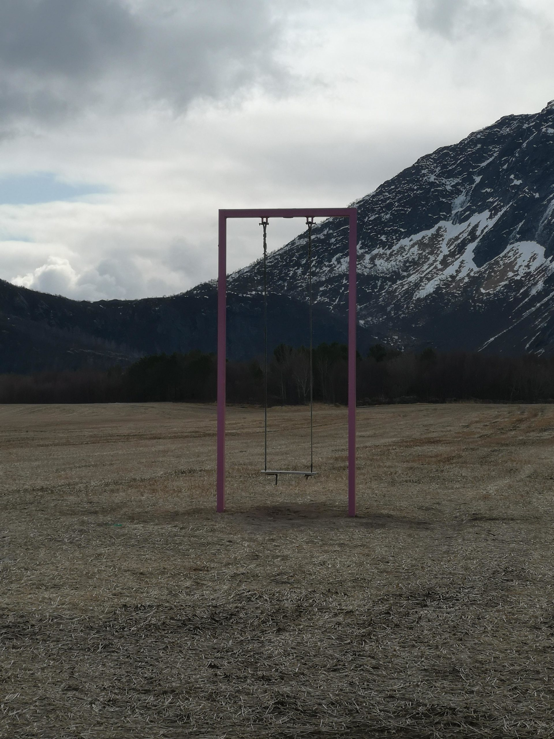 This random swing in the middle of a field
